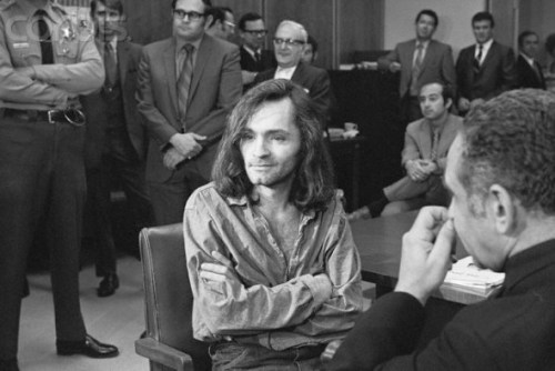 """19 Jun 1970, Santa Monica, California, USA --- """"I Don't Have Any Guilt"""" said long-haired hippie chieftain Charles Manson, 35, in brief press conference in courtroom here, June 18, where a hearing to continue proceedings in the murder case of musician Dary Hinman was held.  Manson's trial for the slaying of actress Sharon Tate and four others last August 9th, and the killing of a wealthy supermarket chain owner and his wife the day after the Tate murder, began this week and forced postponement of the Hinman case. --- Image by © Bettmann/CORBIS"""